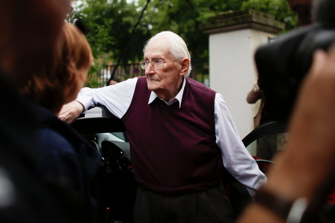 """There were Righteous Gentiles, and then there were Oskar Gröning and thousands of other SS guards like him at Nazi concentration camps who participated in the systematic murder of six million Jews and others during the Holocaust, whether they personally dropped the poison gas pellets in the showers or not. Yesterday in Germany, Gröning was convicted of complicity in the deaths of 300,000 Hungarian Jews at Auschwitz-Birkenau. He went on trial in April, acknowledging """"moral responsibility"""" but adding so many qualifications, reasons and excuses that survivors didn't consider it a satisfactory apology – and neither did the judge. He was sentenced to four years in prison, but as a frail elderly man he may not serve any time, pending appeals. See today's video below. (Markus Schreiber/Associated Press)"""