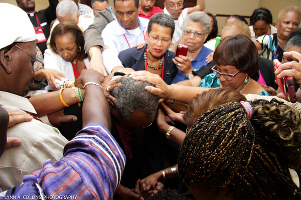 Members of the Union of Black Episcopalians laid hands on Michael Curry at their gala last week, exercising the priesthood of all believers after he was elected the next Presiding Bishop. (Lynn A. Collins)
