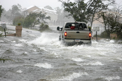 A pickup made its way through a flooded street in Pensacola, Florida, as Hurricane Katrina passed through the area August 29, 2005. The wide swath of the destruction, from Florida and Alabama to Mississippi, Louisiana and Texas, left millions of people feeling abandoned as the media focused on New Orleans. (Peter Cosgrove/Associated Press)