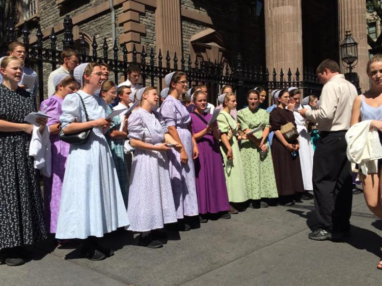 A choir of young Mennonites singing outside St. Paul's Chapel on 9/11 last year to commemorate the lives lost, the loving heroism shown by first responders and volunteers, and the radical hospitality of St. Paul's, which is directly across from the old World Trade Center. (Trinity Parish in the City of New York)