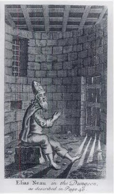 Elias Neau in the Dungeon. A French sailor who belonged to the Huguenot (Reformed) Church, he left for England then America when France revoked the Edict of Nantes, which had given Protestants limited religious freedom. In 1692 he commanded a merchant ship which was captured by a French privateer in Jamaica; when they discovered he was not Catholic, they reduced him to a galley slave and returned him to France, which imprisoned him, and eventually put him in solitary confinement when he wouldn't renounce his faith. In prison he wrote hymns and letters to his wife and the American Puritan preacher Cotton Mather. These were published after he was released, and the New York Huguenot church made him an elder. In 1702 he established the city's first African free school with the help of the rector of Trinity Church and the Society for the Propagation of the Gospel in Foreign Parts. (rodama1789.blogspot.com)