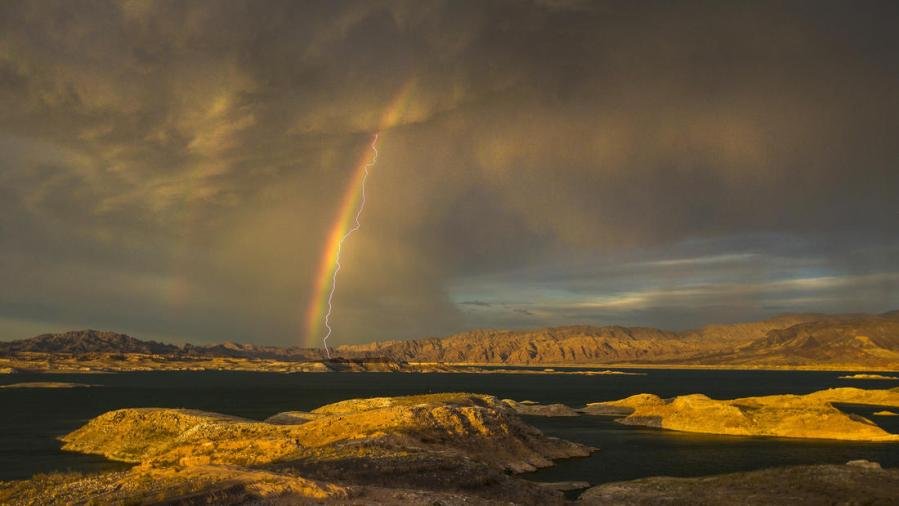 Rainbow and lightning over Lake Mead, Nevada: storm clouds and thunderbolts, glorify the Lord. (Allen Schaben/Los Angeles Times)