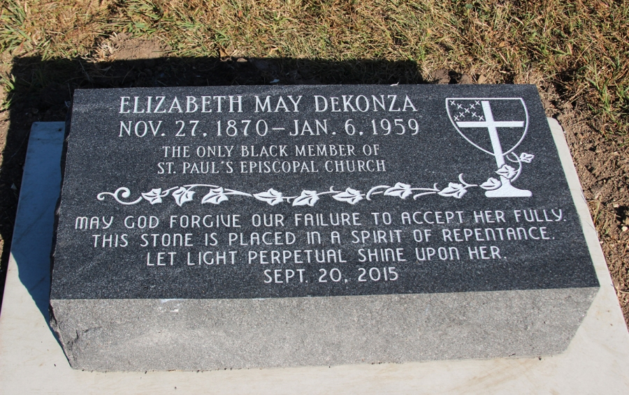 Ms. DeKonza's new gravestone, placed 56 years after her death. The Episcopal Church shield in the upper right forms the bowl of a chalice in remembrance of how the church repeatedly shamed her at the altar of Christ.