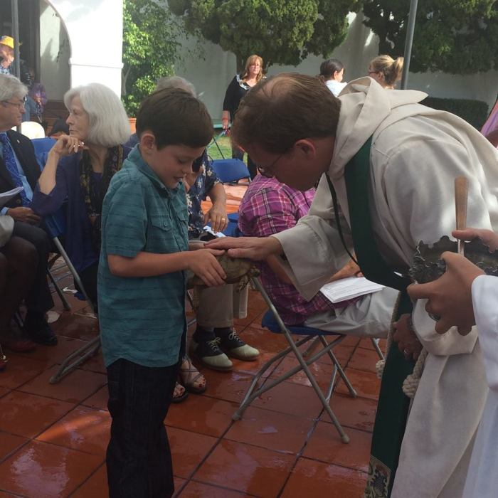 Many parishes have already celebrated St. Francis's Day by blessing animals during regular Sunday worship. Above: a boy with a turtle last year at St. Clement's by-the-Sea, San Clemente, California. (Katrina Soto)