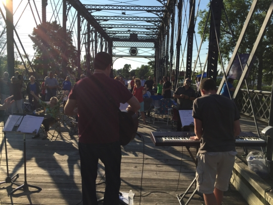 CityWide Prayer Meeting last summer over the Wells Street Pedestrian Bridge in Fort Wayne, Indiana; when people are outdoors and hear music, they invariably head that way. (Journal Gazette)