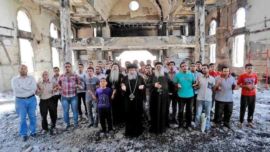 Coptic men stand in the ruins of this unidentified church in Egypt, where in 2013 the ouster of President Morsi set off a wave of anti-Christian violence. More than 50 Coptic churches and institutions were set afire, along with thousands of homes and businesses, and at least 11 people were killed. Now the new president Abdel Al-Sisi is vowing to rebuild and repair the churches, part of a religious charm offensive with political overtones aimed at consolidating support among both Muslims and Christians. (All photos: egyptianstreets.com)