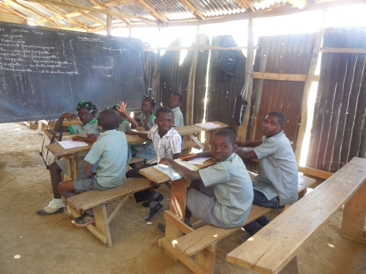 Education is highly valued by Haitian parents. The children may go to a school with a dirt floor, but they work once they get there. (Beth Spell)