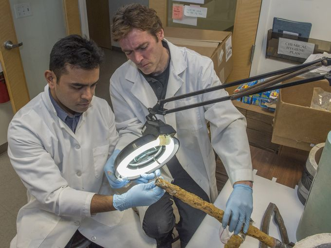 Prof. Edwards, right, of Virginia Tech has now been appointed by Michigan's governor to a task force to clean up the water in Flint. Look at the pipe he's holding. (Detroit News)