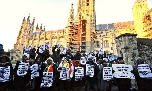 This may be the most important photo to come out of last week's Primates' Meeting in Canterbury: African LGBTs protesting Anglican endorsement of homophobic scapegoating and violence in Africa and Asia. (Frank Augstein/Associated Press)