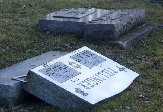 The Jewish cemetery in Fort Wayne, Indiana was vandalized recently, with about 60 headstones pushed over or broken. Police theorize that two or more people were necessary to do that much damage, but so far they're not calling it a hate crime for lack of any anti-Semitic graffiti. (News-Sentinel)