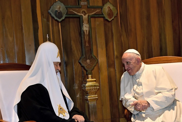 """Russian Orthodox Patriarch Kirill II met Pope Francis at the airport in Havana Friday, the first such meeting since the Great Schism of 1054. The Russian is not the spiritual head of Orthodoxy – that distinction belongs to the Patriarch of Constantinople – the Russian Church is its largest. So while secular media busy themselves analyzing the current politics of this meeting (and they are fraught), let us give simple thanks that two Christian leaders have finally managed to overcome a thousand years of hatred, bitterness and rivalry """"that we all may be one."""" (Gabriel Bouys/AFP)"""