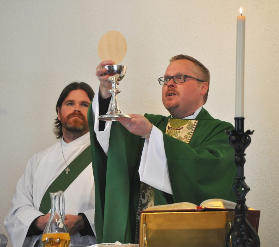 Newly ordained deacon Brian Barry serving at his first Eucharist last Sunday at St. Luke's, Wantagh, New York, where rector Christopher Hofer celebrated the true food and true drink. (Facebook)