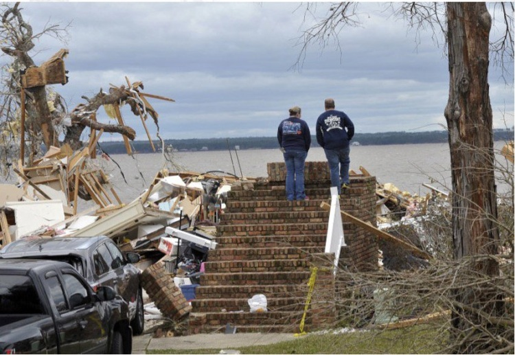 This was their home in Pensacola, Florida, until Tuesday, when a winter tornado damaged or destroyed 300 dwellings. Related storms from Louisiana to Massachusetts killed nine people. (Tony Giberson/Pensacola News-Journal)