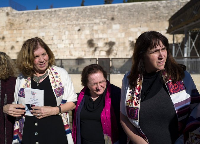 The state of Israel has finally announced a compromise in how it allocates worship space around the Western Wall in Jerusalem, which since 1948 has been controlled by Orthodox leaders to the exclusion of Conservative and Reform Jews and their women. A new worship plaza will be developed south of the current gathering place adjacent to the retaining wall, which once surrounded the Temple Mount. For 27 years, Women of the Wall have been agitating for their right to worship there, suffering arrest, persecution and political denunciation for wearing prayer shawls traditionally worn by men. Orthodoxy maintains gender separation in its services and hasn't recognized the non-Orthodox as Jews at all. The vast majority of American Jews are Conservative or Reform, and the constant controversy led to alienation and disunity. (Jim Hollander/European Pressphoto Agency)