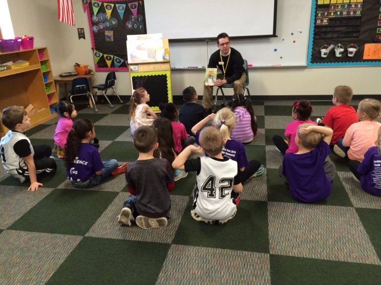 Real Men Read: The Rev. Gray Lesesne, vicar of Good Samaritan, Brownsburg, Indiana, reading to public schoolchildren as part of a program to get more men into the classroom. This Episcopal congregation bills itself as a church without walls, a phrase they stole from us (or we lent to them).