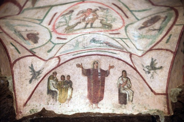 The Catacombs of Priscilla in Rome, restored in 2013. Does this mural depict a woman priest? The Vatican denies all possibility of it, but other scholars disagree. (Gregorio Borgia/Associated Press)