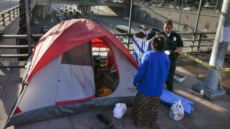 Police swept scores of homeless people from their village above the 101 Freeway last week in Los Angeles. Because, you know, mental hospitals cost too much and everyone who wants to work can find a job. (Mark Boster/Los Angeles Times)