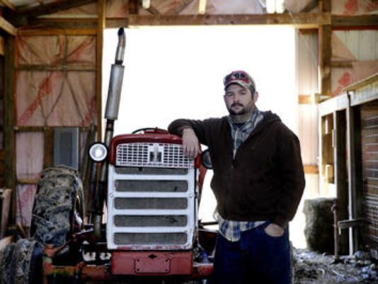 """Widening his charity: Jonathan Lawler, a farmer near Greenfield, Indiana, has converted his small for-profit farm to a community-supported nonprofit, and hopes to distribute 500,000 pounds to the local food bank and other programs. He doesn't need the income from the 36-acre farm, so he is switching from commodity grains and mobilizing volunteers to raise """"people food"""" instead. (Michael McEldowney/The Indianapolis Star)"""