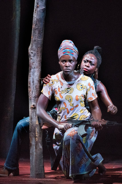 """Academy Award-winner Lupita Nyong'o, front, and Zainab Jah are among the stars in """"Eclipsed,"""" an acclaimed new play by Danai Gurira which just opened on Broadway, and is centered on four captive """"wives"""" of a rebel officer during the Liberian civil war at the start of this century. Liberian women, both Muslim and Christian, helped bring about an end to the war when they united to demonstrate for peace. (Sara Krulwich/The New York Times)"""