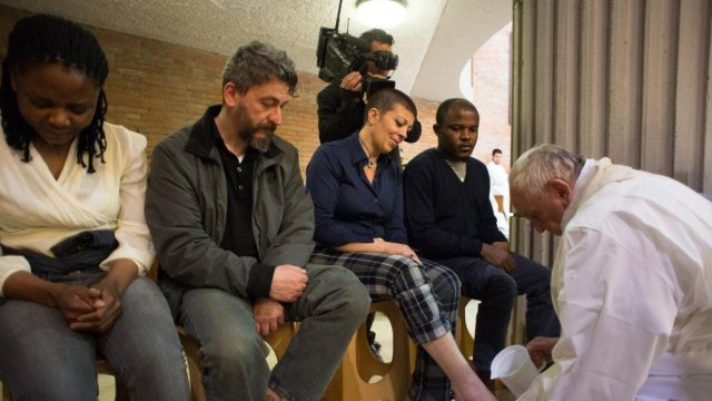 Pope Francis washing the feet of Syrian refugees and others, a week ago on Maundy Thursday.