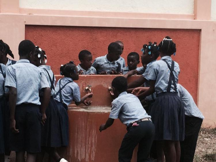 The fountain at St. André's School, Mithon, Haiti. These are our kids; this is our school, which your donations to this website help support. (Père Jean Michelin St. Louis)