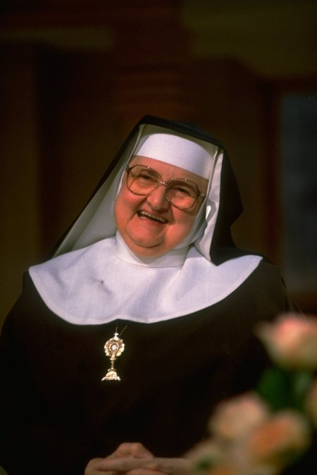 """Mother Angelica has died, the founder and face of the Eternal Word Television Network – on Easter Day, no less, after a hugely successful career as a religious entrepreneur. Her reach extended through the whole world from little Irondale, Alabama. Charismatic and determined, she built the whole thing from scratch, driven by her personality, outspokenness and certainty. Her reactionary beliefs got her in trouble at times with various archbishops but endeared her to audiences. A Jesuit priest, Fr. Raymond Schroth, wrote of her, """"Anyone who watches EWTN will have to conclude that Catholicism is a Disneyland of pseudo-miracles, with a piety that exalts Mary over Jesus, more determined to squelch the Spirit than allow him or her to speak."""" She thought Mass should be in Latin, Vatican II was a nightmare and whatever the Pope says is the last word, as long as he was conservative. But there was never any question she was good at what she did. Early in her career she got a major boost from Protestant televangelist Pat Robertson, and with that she was on her way. (William F. Campbell for Life Images Collection/Getty)"""
