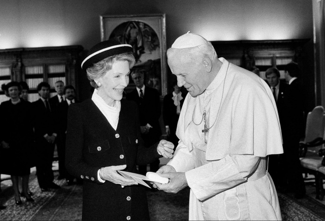 Former U.S. First Lady Nancy Reagan has died at age 94. She met her husband Ronald Reagan when both were actors in Hollywood; they had a long and happy marriage, and she was a great comfort to him as well as a principal advisor. Above, with Pope John Paul II in 1985. (Associated Press)