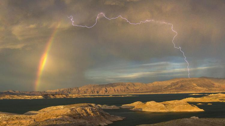 For the beauty of the Earth: rainbow and lightning over Lake Mead, Nevada. (Allen Schaben/Los Angeles Times)