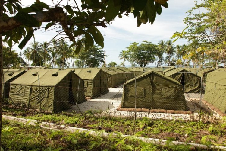 This Australian-run detention center for 800 immigrant/refugee men on Manus Island in Papua New Guinea was found illegal yesterday by the highest court in PNG; the Australian government immediately declared that its immigration policies will not change. There are additional camps in Papua for women and children. Meanwhile we observe that a photo of tents is not the same as a picture of human beings, and that people have been living behind this barbed wire for years. (Australian Department of Immigration and Citizenship)