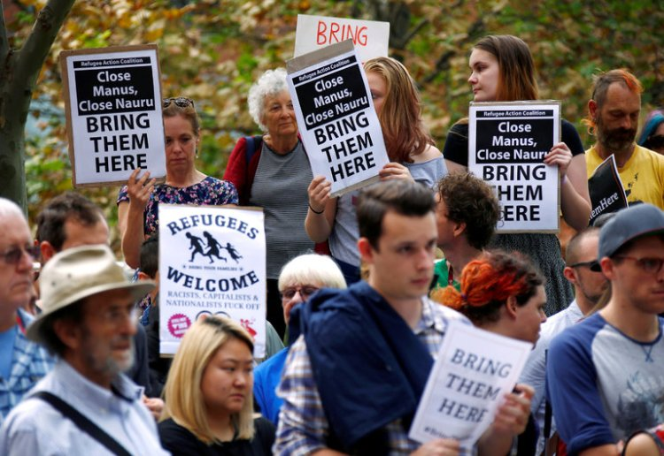 Demonstrators Friday at the Department of Immigration and Border Protection in Sydney, protesting the indefinite offshore detention of stateless Rohingyas, mostly from Burma. (David Gray/Reuters)