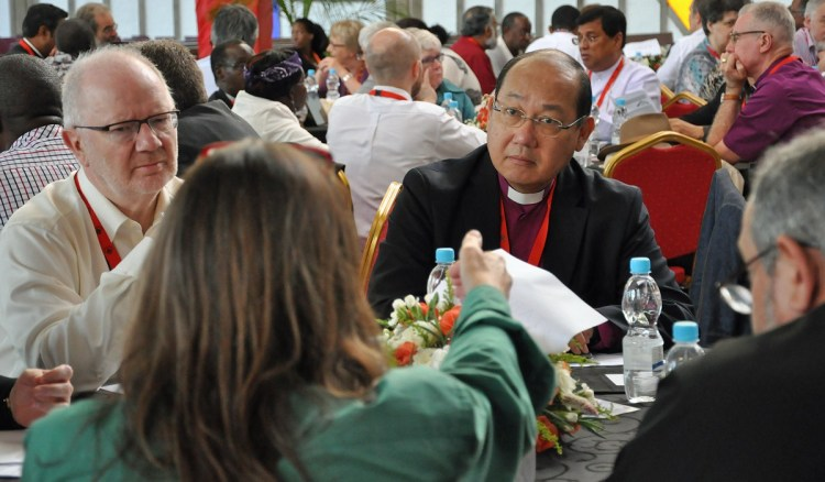 "The Archbishop of Hong Kong, Paul Kwong, was elected chairman of the Anglican Consultative Council at its meeting yesterday in Lusaka, Zambia. ""The most important issue is to hold the Communion together,"" he said. The council includes bishops, priests, deacons and laypeople, but hasn't had a lay chair since 1999. The national primates have their own meeting, one of four ""instruments of communion"" along with the council, so Archbishop Kwong is now a power in two of the four. Rosalie Ballentine, lay representative of The Episcopal Church, called for a ""balance of power"" and noted, ""The ACC is the one instrument with laypeople on it. Laypeople need to have a voice in the leadership of the communion and not be subject to the four-part governance of primates. Shared decision-making is part of our identity as Anglicans."" Kwong defeated a layperson from Brazil for the chairmanship, 40-25. (Mary Frances Schjonberg/Episcopal News Service)"