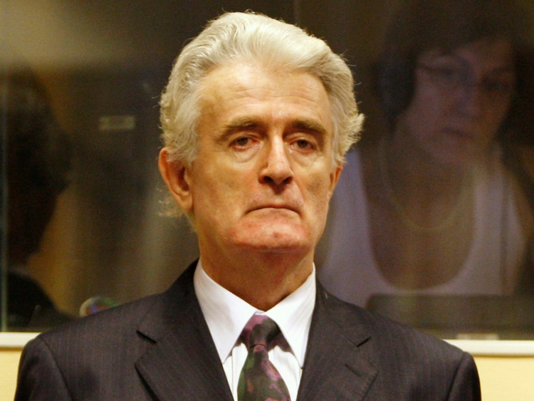 "Former Bosnian Serb leader Radovan Karadzic was finally convicted 28 March at the U.N.'s Yugoslav war crimes tribunal in The Hague, Netherlands, more than 20 years after Bosnia's war, and sentenced to 40 years' imprisonment for genocide and war crimes against Bosnian Muslims and Croats at Srebenica; his policy of ""ethnic cleansing"" was to kill every able-bodied male in town. He's a former psychiatrist; when he became president of the Bosnian Serbs in 1994, he was decorated by the Greek Orthodox Church, which declared him ""one of the most prominent sons of our Lord Jesus Christ working for peace."" At the same time in Russia, the Ecumenical Patriarch Bartholomew announced that ""the Serbian people have been chosen by God to protect the western frontiers of Orthodoxy."" (Jerry Lampen, pool photo via Associated Press)"