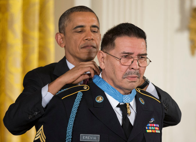 Santiago Erevia has died, one of 24 veterans of World War II, Korea and Vietnam who were denied America's highest military award, the Medal of Honor, because they were Hispanic, Jewish or Black. Above, he finally was decorated by President Obama in March 2014 after a Congressional investigation; he was one of only three who were still living. A radio telephone operator on May 21 1969, in a coastal town south of Da Nang, Vietnam, he was deployed to lag behind his company to treat the wounded. But when his companions got shot, he gathered up their M-16s and hand grenades and stormed four bunkers, shooting with both hands and wiping out the enemy. He was sure he would be killed, but he wasn't – so then he went back to caring for the wounded. (Balce Ceneta/Associated Press)