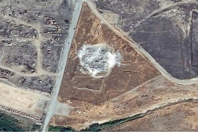 Satellite image of what St. Elijah's Monastery looks like now that ISIS is done with it. They don't just destroy antiquities at random; they choose those they believe are meaningful to Christians in the West. (DigitalGlobe via Associated Press, 2014)