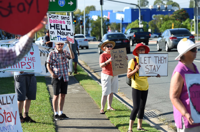 "Australia's immigration policy remains controversial throughout the world as well as an issue in the current election campaign; the vote is to be held July 2. A vocal and persistent minority have protested the policy of incarcerating would-be refugees offshore and indefinitely, a practice condemned by Amnesty International and the United Nations. But often the protesters are few, as in this photo taken two months ago. With nations closing their borders, climate change accelerating, a few islands already swamped and heavily populated coastal areas threatened in a generation or two, where are the world's climate refugees supposed to go if they're the ""wrong"" religion or ethnicity? (Dan Peled/European Pressphoto Agency)"