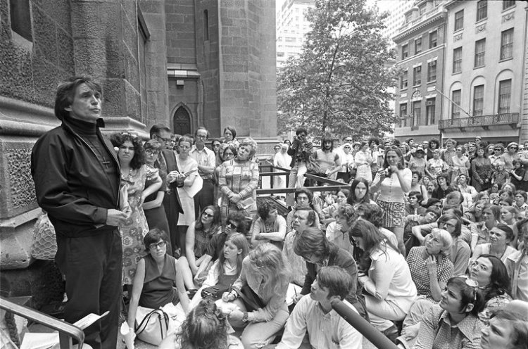 "Fr. Daniel Berrigan has died, a poet, Jesuit priest and lifelong peace activist. He and his brother Philip, also a priest, caused a sensation in 1971 after they burned draft records outside a Knights of Columbus Hall in Catonsville, Maryland at the height of the Vietnam War. They were arrested, tried and imprisoned; Daniel made a play out of the trial transcripts called ""The Trial of the Catonsville 9,"" which has received many productions since its debut. Above: giving an antiwar sermon in front of St. Patrick's Cathedral in New York City in 1972. (William E. Sauro/The New York Times)"