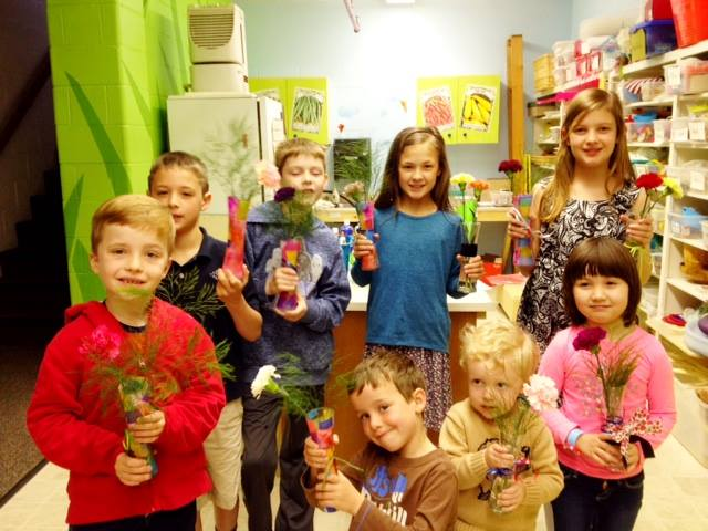 The children of St. John's, Crawfordsville, Indiana presented their mothers with flowers in hand-decorated vases yesterday for Mother's Day – and attendance almost matched Easter. Who could resist those faces? (Jan Oller)