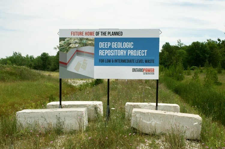 "Citizens and politicians on both sides of the U.S.-Canadian border are alarmed by a plan to store intermediate nuclear waste deep underground near Kincardine, Ontario, and their concern isn't simply ""not in my back yard."" It's that the site chosen by the electric utility is less than a mile from Lake Huron, one of North America's five interconnected Great Lakes, which supply drinking water to tens of millions of people. It's the largest freshwater ecosystem in the world, holding 20% of the planet's supply. And though geologists say the rocks underground are the ideal storage site, human beings haven't done anything perfectly since Christ rose from the dead. Contaminate the Great Lakes and they'll make the lead poisoning in Flint, Michigan look like child's play. Notice the sign doesn't contain the word ""nuclear."" (Steve Friess)"