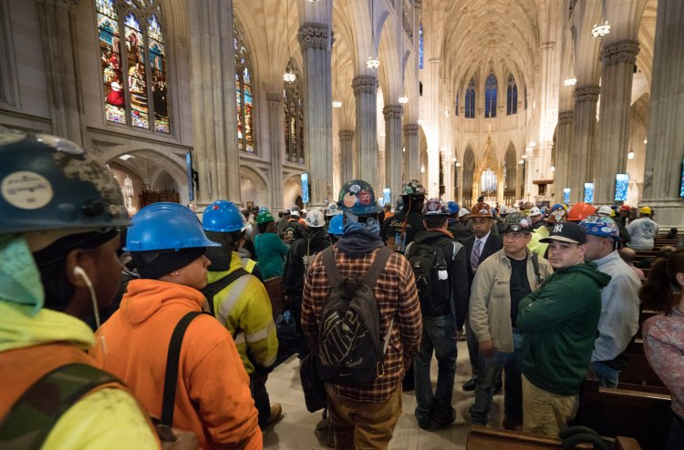 A Mass for construction workers last week at St. Patrick's Cathedral, New York, remembering the 16 workers killed in the city last year on the job. The cathedral has hosted this annual Mass since 2008. (Sara Krulwich/The New York Times)