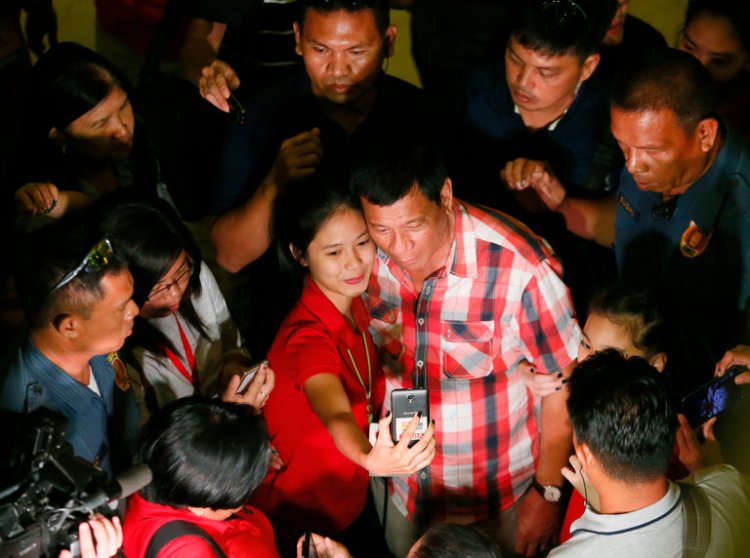 """The Philippines has elected Rodrigo Duterte, the mayor of Davao, as its next president, despite his support for death squads and his jokes about a woman who was raped and killed. The current President, Benigno Aquino III, predicts the nation will return to Marcos-style dictatorship. American media call Duterte the """"Filipino Trump."""" (Bullit Marquez/Associated Press)"""