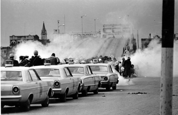 Clouds of tear gas fired by state police on civil rights marchers at the Edmund Pettus Bridge in Selma, Alabama on March 7, 1965. Police beat these peaceful citizens without mercy for demanding the right to vote. (Associated Press)