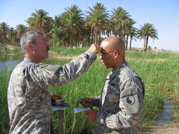 Chaplain Weatherly administering a field baptism in Iraq, 2006. (Family Photo)