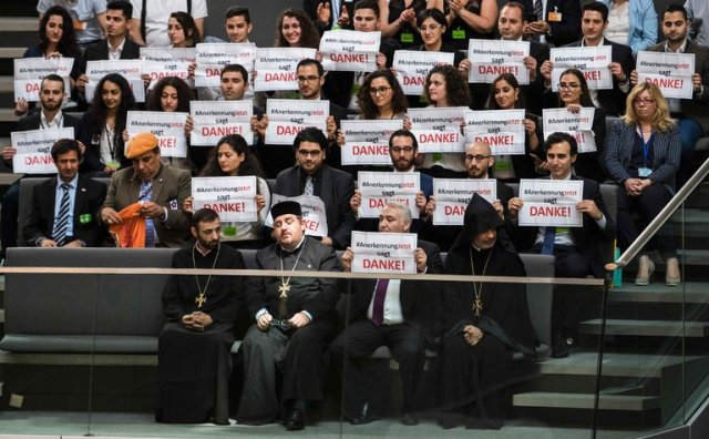 Yesterday the German Parliament recognized the Armenian Genocide of a hundred years ago, in a nearly unanimous vote in the lower house; above we see the reaction of Armenians in the gallery. More than a million Armenians and other Christian minorities were killed as Germany's ally the Ottoman Empire disintegrated in 1915-16; Germany now admits it failed to act on information it knew at the time. Turkey, the Ottomans' successor state, has always denied that the massacres constituted genocide, and responded by recalling its ambassador after the vote. (Odd Andersen/AFP)