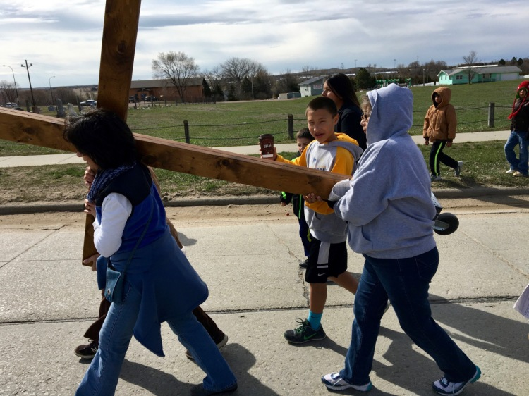 Children and community members carried the cross through the streets of Mission, South Dakota on Good Friday 2016, sponsored by Rosebud Episcopal Mission on the Lakota Sioux Indian Reservation. Our gifts to the Rez support their GLORY children's program and heating supplies during the bitterly cold winters. (The Rev. Dr. Lauren M. Stanley)