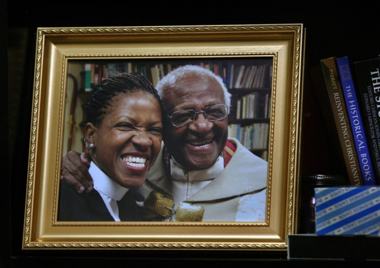 Desmond Tutu's youngest daughter Mpho has announced that she married a female physician from the Netherlands last December at an Episcopal church in Virginia. The Church in South Africa doesn't allow its clergy to enter into same-sex marriages, so she voluntarily turned in her license to serve as a priest there. But she is also licensed in the USA, where she attended seminary. She is now the director of the Desmond and Leah Tutu Legacy Foundation and frequently appears as heir apparent with her father on social media. South Africa is unique among nations in prohibiting discrimination on the basis of sexual orientation, and the Anglican Church there is expected to revisit its prohibition on LGBT married clergy later this year. (The Washington Post)