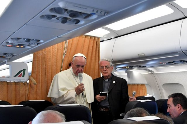 """Pope Francis, returning to Rome from Armenia Sunday, told reporters the Church should apologize to Gay people, women and the poor, and stop blessing so many weapons. His comment about LGBTs made headlines, but the wide range of his remark seemed to dilute its impact; musing about what the Church """"should"""" do rather than making an actual apology. (Tiziana Fabi/AFP)"""