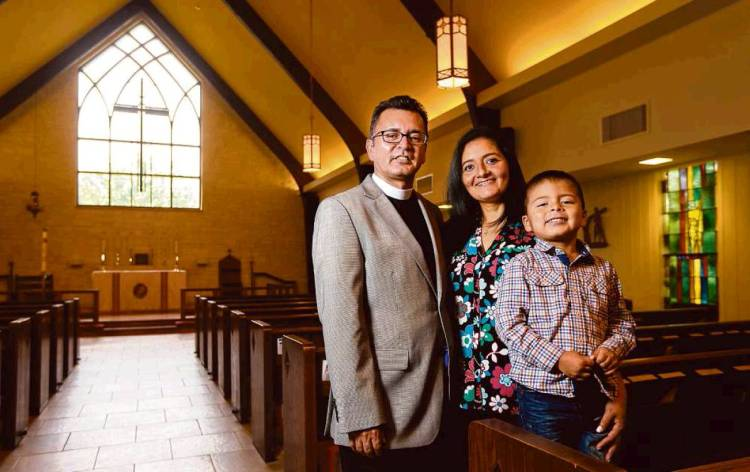 "The Houston Chronicle on Sunday ran a big story on two local Episcopal priests, Frs. Pedro and Uriel Lopez, whose parishes are helping to lead significant growth in Latino ministry in the Diocese of Texas. They are brothers, formerly Roman Catholic priests, who left to become Episcopalians, marry and have families. They feel their lives are more balanced now, that family life helps them carve out time away from the constant demands on the clergy. Our Honorary Deacon Clint, a parishioner of Fr. Pedro's, says, ""These guys are going places in the diocese."" Above: Fr. Uriel with wife Lucia and son Carlos of St. Christopher's, Houston. (Gary Coronado/Houston Chronicle)"