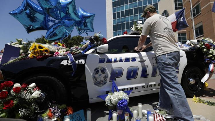 Impromptu shrine for five slaim police officers in Dallas. (Eric Gay/Associated Press)