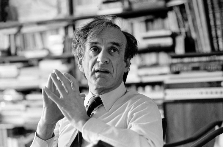 """Elie Wiesel has died, the Auschwitz survivor, author and speaker who did more than anyone else to make sure the world never forgets the Holocaust. He won the Nobel Prize for Peace in 1986; """"Wiesel is a messenger to mankind,"""" the Nobel citation said. """"His message is one of peace, atonement and human dignity. His belief that the forces fighting evil in the world can be victorious is a hard-won belief."""" (Neal Boenzi/The New York Times)"""