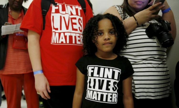 Six more Michigan state employees were arrested last week in the Flint water scandal, in which an American city's water supply was poisoned by lead while officials looked the other way. The new charges include falsifying records; nine state bureaucrats have now been accused. Residents of Flint, who are mostly poor and mostly black, have been drinking bottled water since the contamination was finally revealed. (Kevin Lamarque/Reuters)